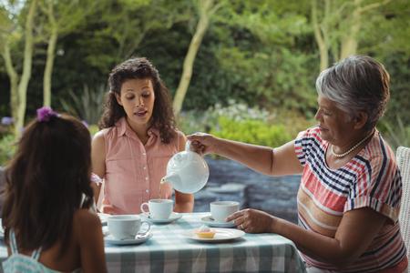 Happy family having tea at home