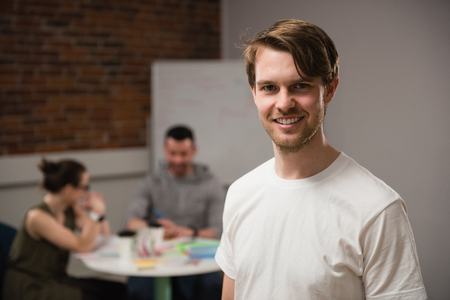 Portrait of smiling executive in office Stock Photo
