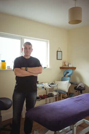 bodycare: Portrait of therapist standing with arms crossed in spa LANG_EVOIMAGES