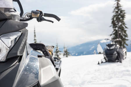 wintertime: Empty snowmobiles on a snowy alps during winter season