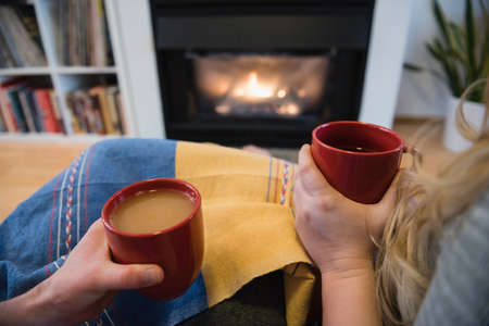 luxury apartment: Close-up of couple having coffee while in living room at home