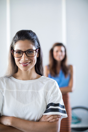 Portrait of female executive in spectacle standing in office