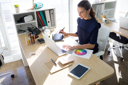 stylus pen: Female executive working over graphic tablet at her desk in office