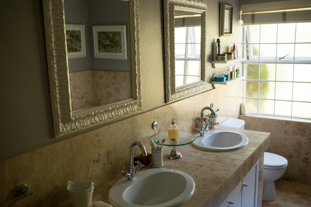 sinks: Mirror over sinks in bathroom at home