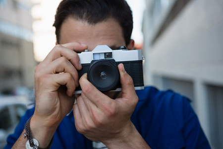frizzy: Close up of man photographing with camera