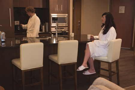human likeness: Couple having coffee in the kitchen at home