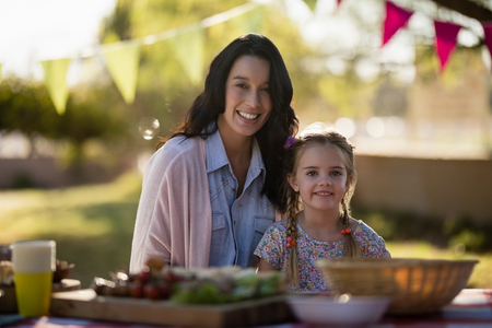 Portrait of mother and daughter enjoying together in the park on a sunny day Stock Photo