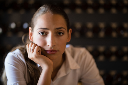 Portrait of unhappy woman sitting in bar