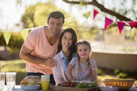 Portrait of happy family enjoying together on picnic Stock Photo