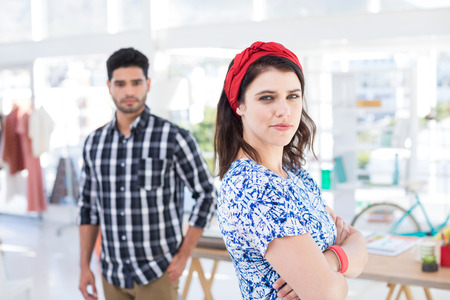 Portrait of couple standing together in the office