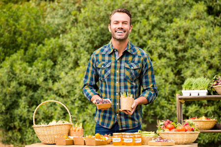 looking for job: Portrait of handsome man selling organic vegetables at farm