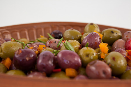 Close up of olives served with chili pepper in container