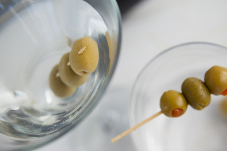 toothpick: High angle view of olives in vodka martini on table