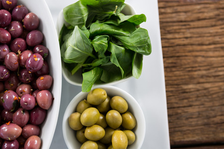 Close-up of marinated olives with herbs in bowl Stock Photo
