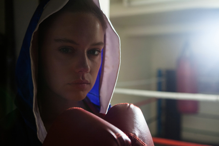 Beautiful woman practicing boxing in fitness studio Stock Photo