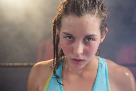 Close-up of young female boxer at fitness studio Stock Photo