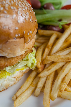 Close-up of hamburger and french fries on table Stock Photo