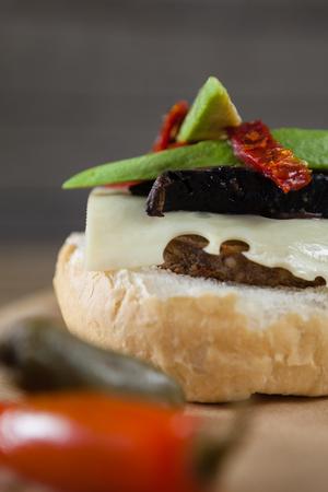 Overhead of burger on wooden plank Stock Photo