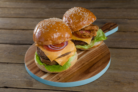 Overhead of hamburgers on chopping board