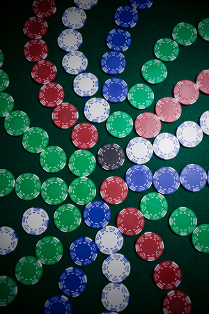 Casino chips arranged on poker table in casino
