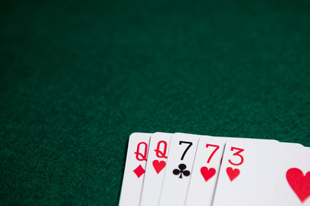 Playing cards arranged on poker table in casino