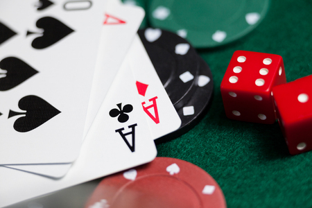 Close-up of playing cards, dices and casino chips on poker table Stock Photo