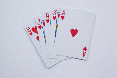 Close-up of playing cards arranged on white background