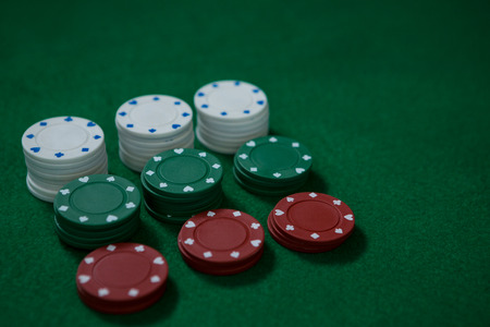 High angle view of poker chips on green table Stock Photo