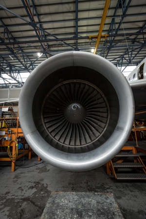 Close-up of turbine engine of an aircraft at airlines maintenance facility