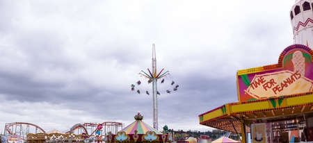 Various rides and store in amusement park at day LANG_EVOIMAGES
