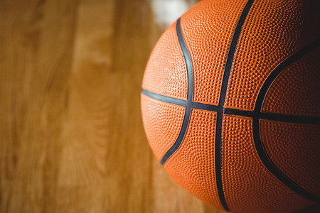 Extreme close up of orange basketball on floor in court Stock Photo