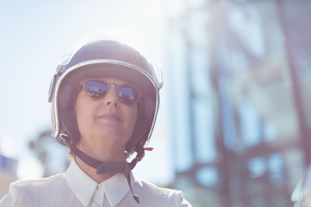 Low angle view of businesswoman wearing helmet on sunny day