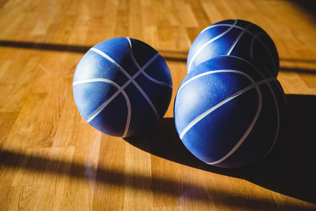 Hgh angle view of blue basketballs on floor in court Stock Photo