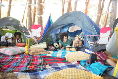 Couple relaxing in tent at campsite