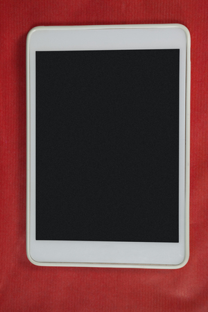 back ache: Close-up of digital tablet on red background