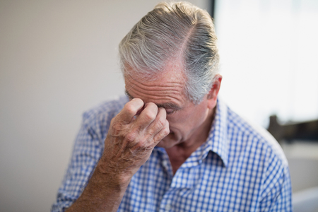 Close-up of worried senior male patient at hospital ward