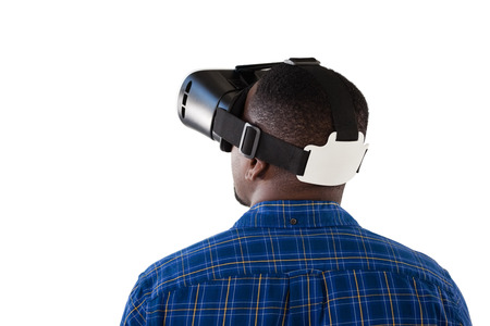 Rear view of man using virtual reality headset against white background