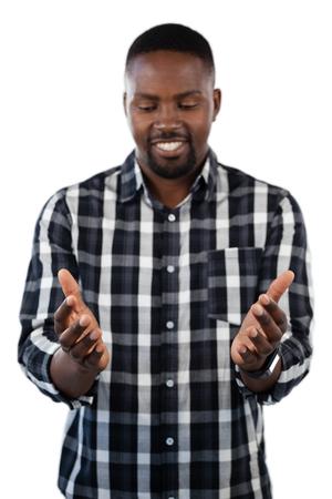 checker: Happy man gesturing against white background Stock Photo