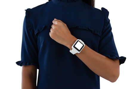 Mid section of female executive showing her smartwatch