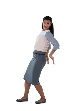 Businesswoman pushing behind against white background