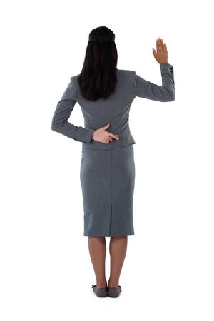 carretilla: Vista posterior de empresaria levantando su mano sobre fondo blanco