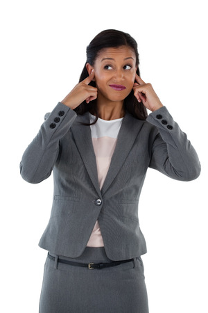 Irritated businesswoman covering her ears. Hear no evil concept Stock Photo