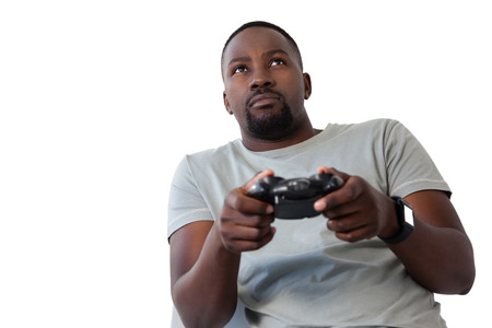 Close-up of man playing video game against white background Stock Photo