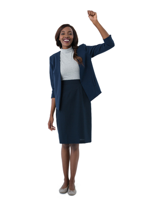 Full length of happy businesswoman standing against white background