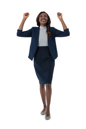 Full length of cheerful businesswoman standing against white background Stock Photo