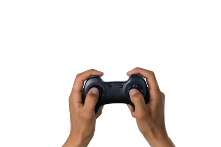 Cropped of hand holding controller against white background