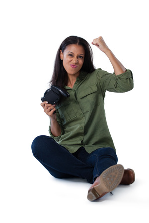 Excited woman playing video games against white background Stock Photo