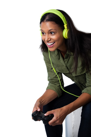 Smiling woman playing video game against white background