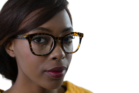Close up portrait of young woman wearing eyeglasses against white background