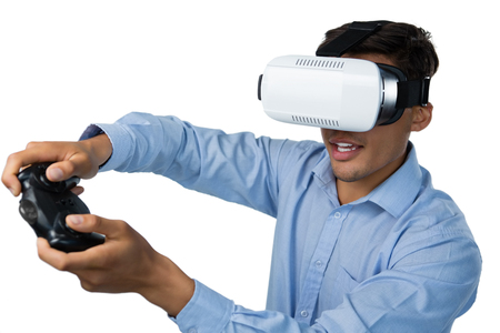 Creative businessman wearing vr glasses while video game against white background